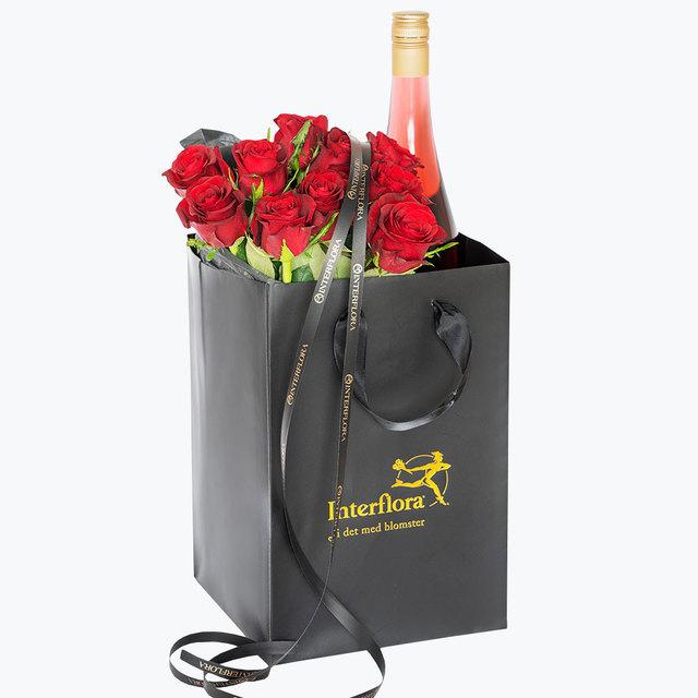 Bilde av  10 røde roser og cider i gavepose